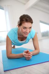 Woman doing pushups in gym
