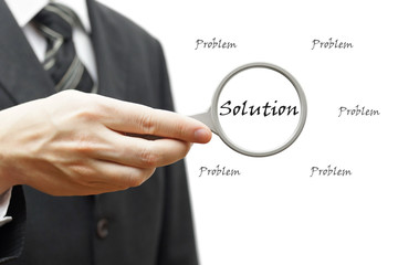 Problem and Solution - Business Concept with businessman and mag