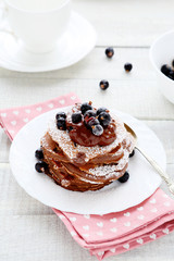 chocolate pancakes with sauce and berries