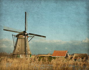 View of windmill at Kinderdijk, Netherlands. Paper  texture.