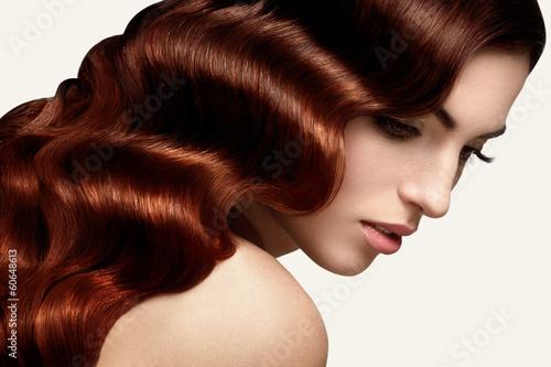 Leinwanddruck Bild Brown Hair. Portrait of Beautiful Woman with Long Wavy Hair. Hig