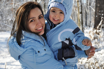 Winter portrait of mother and baby boy