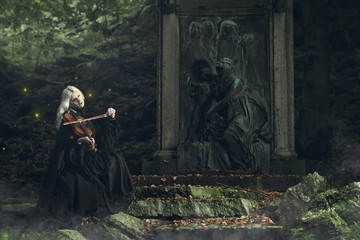 Gothic portrait of a dark lady playing a fiddle