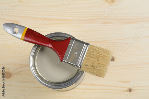 Paintbrush and a can with paint