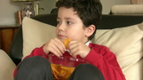Young Boy Eating Potato Chisps