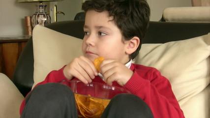 Young Boy Eating Potato Chisps