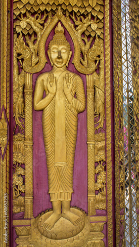 Golden Buddha Carving on Thai Temple Door
