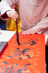 The man writing Chinese spring festival couplets