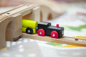 little toy wooden train rides on Rails