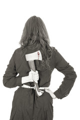 Businesswoman holding an axe behind her back, bw on white.