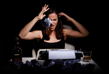 Novelist throwing wrinkled paper because of writer's block
