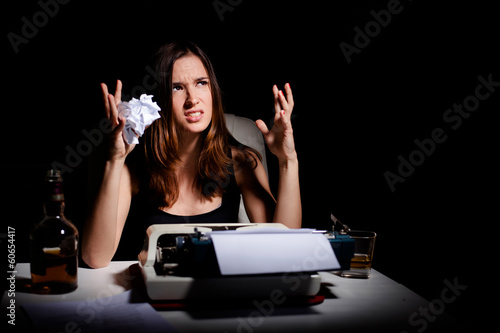 Frustrated young writer having writer's block