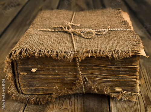 Old book wrapped in canvas