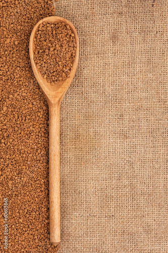 wooden spoon with granulated coffee