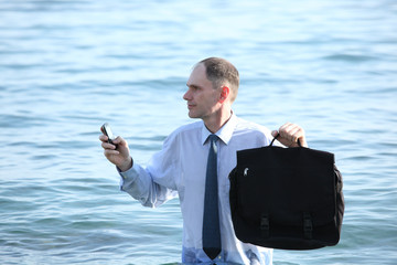 Businessman in a water