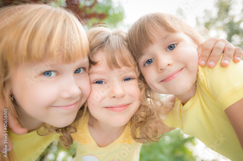Low angle view portrait of happy children