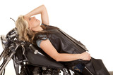 woman lay back on motorcycle elbow up