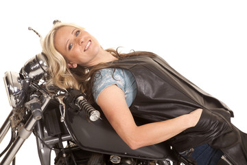 woman leather lay back on motorcycle smile