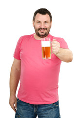 Smiling man holds light beer mug