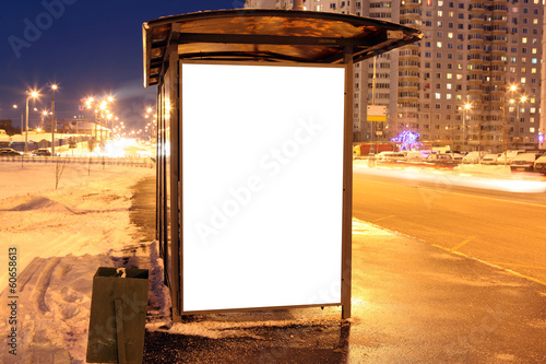 Blank sign at bus stop in city