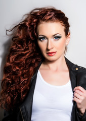 Red Hair. Beautiful Woman with Curly Long Hair