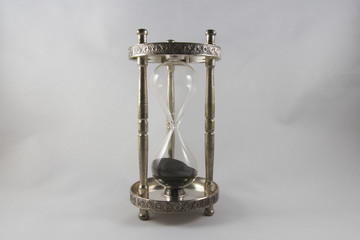 Hourglass – old fashioned hourglass, black sand, empty.