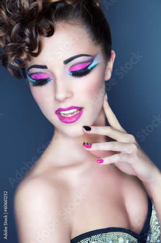 Beautiful young woman with professional party make up