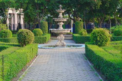Leinwanddruck Bild Fountain in public park