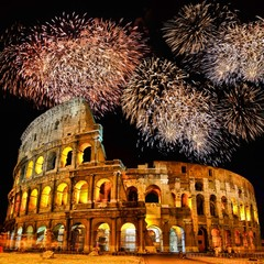 Famous Colosseum of Rome at night with fireworks