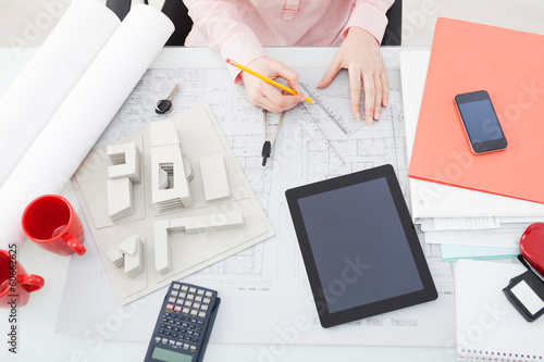 Woman architect working in her office