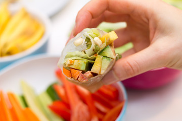 Fresh spring roll with vegetable filling on vibrant background