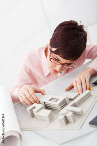 Female professional architect working in her office