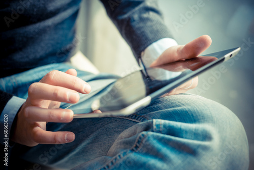canvas print picture close up hands multitasking man using tablet, laptop and cellhpo
