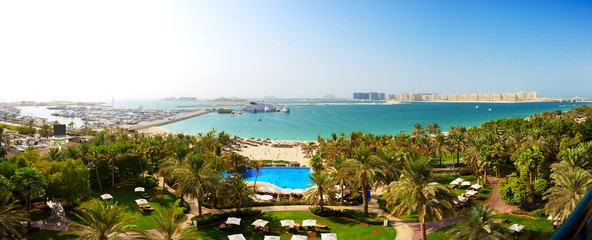Panorama of beach with a view on Jumeirah Palm man-made island,