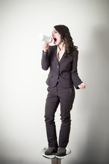beautiful young businesswoman with little megaphone