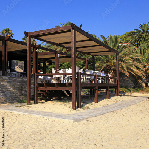 outdoor terrace cafe on sand beach
