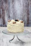 Coconut torte on glass cake stand