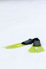 Flippers lying on the snow, conceptual photo