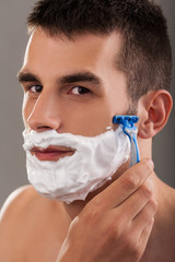 Beautiful male shaving