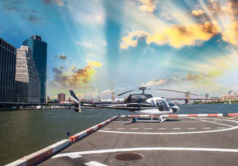 Helicopter on the launch platform in New York with city skyline
