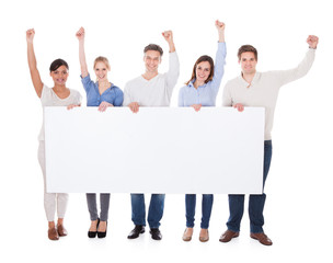 Group Of People With Billboard Raising Hand