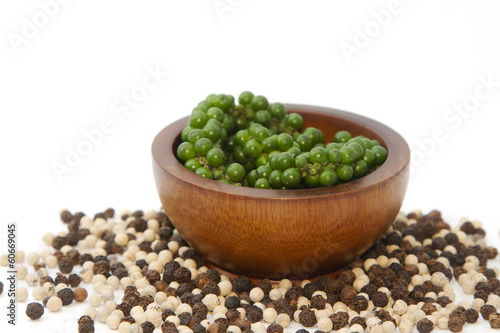 Fresh green pepper on heap of black and white pepper,Thai spice