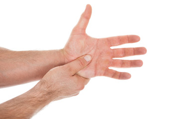 Person Pressing Palm With Thumb