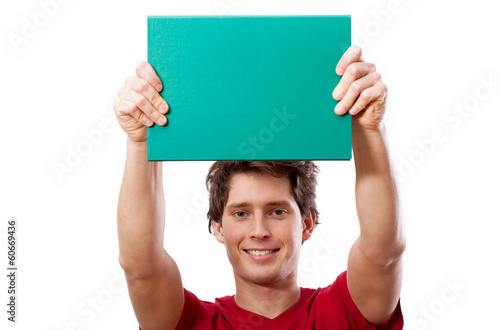 Young smiling man holding green board for your text