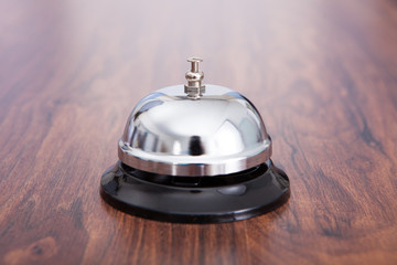 Close-up Of Hand Ringing Service Bell