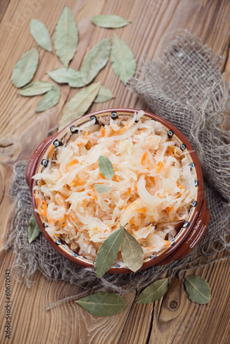 Sauerkraut, wooden background, view from above