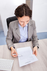 Businesswoman Holding Contract Paper