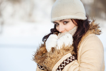 Pretty woman on the winter background