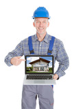 Architect Showing Picture Of Home On Laptop