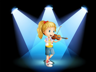 A stage with a young girl playing with her violin